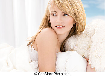 bright picture of lovely teenage girl in bed