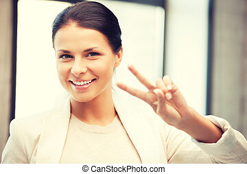 victory - bright picture of lovely teenage girl showing ...