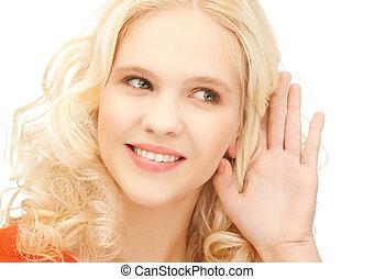girl listening rumors - bright picture of smiling girl...