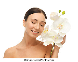 smiling woman with white orchid flower