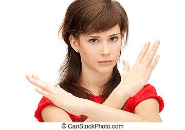 teenage girl making stop gesture - bright picture of teenage...