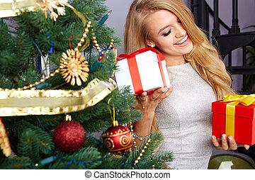 woman decorating christmas tree