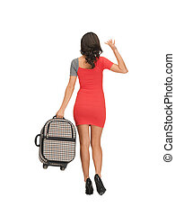 woman with suitcase waving hand - bright picture of woman...