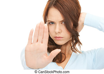 woman making stop gesture - bright picture of young woman ...