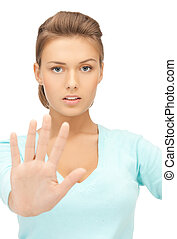 woman making stop gesture - bright picture of young woman...