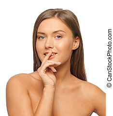 woman with finger on lips