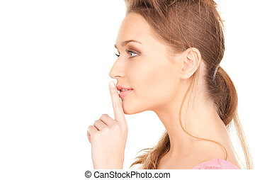 finger on lips - bright picture of young woman with finger ...