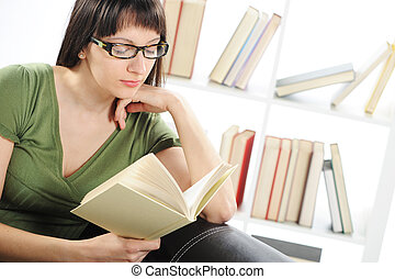 bright picture of young woman woman with book , bookshelf on bac