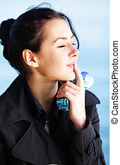 Bright portrait of a beautiful young stylish woman ejoying the weather on the beach