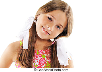 Bright portrait of little girl with white bows