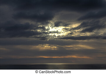 Bright Rays of sun breaks through clouds over ocean expanse 1