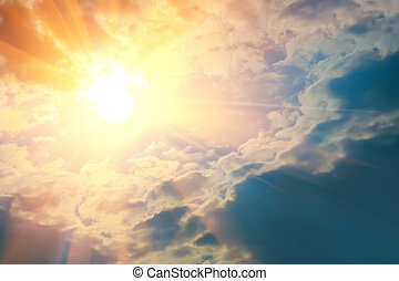 Bright rays of sun shining in blue sky.