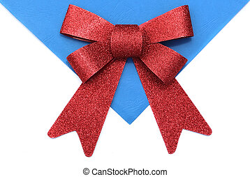 Bright red bow over white and blue background