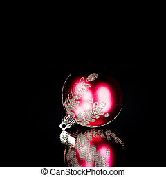 bright red Christmas ball on a black background.