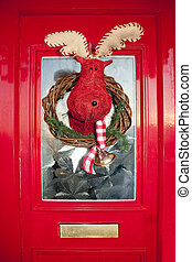christmas front door with handmade reindeer wreath - bright...