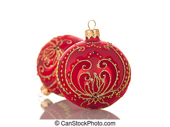 Bright red Christmas toy ball decorated with gold pattern isolated on white