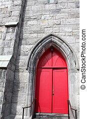 Bright red doors in stone church