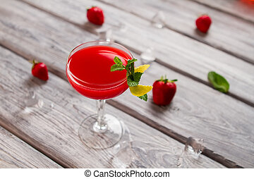 Bright red drink in glass.