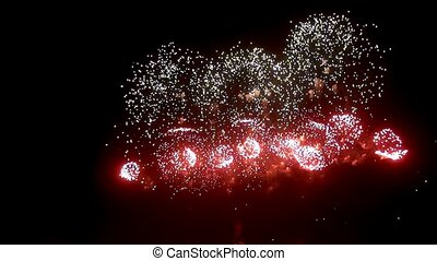 Bright red green yellow explosions of firework display on...