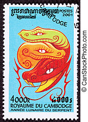 Bright red snake wrapped around cresent moon. Year of the...