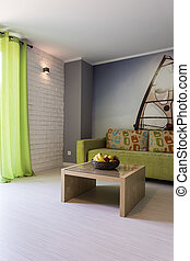 Bright room with green sofa