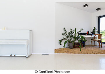 Bright room with piano