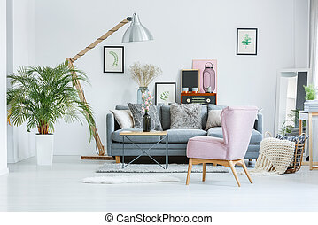 Bright room with watercolor pictures