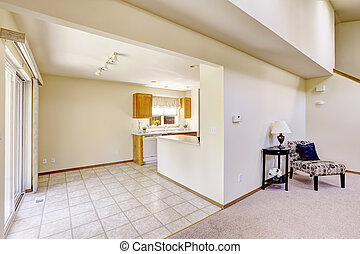 Bright rooms in empty house. Kitchen area with tile floor