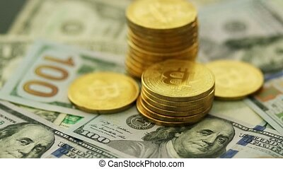 Bright shining bitcoins and dollars - Close-up view of...