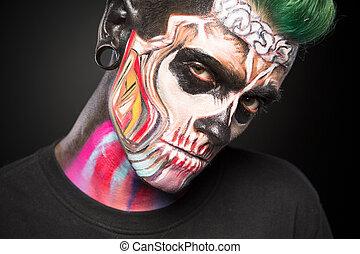 Bright skeleton makeup on mans face. Mystical face art...