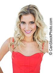 Bright smiling blonde model looking at camera