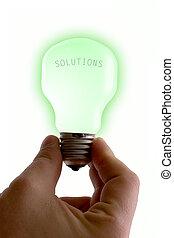 Bright Solutions - Concept : bright idea. Green lit bulb...