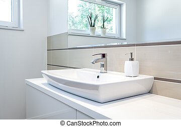 Bright space - tap - Bright space - a silver tap in a white...