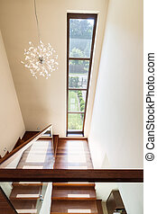 Bright staircase with glass balustrade - Bright wooden...