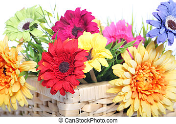 Bright summer flowers in a basket
