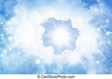 Bright sun in blue sky
