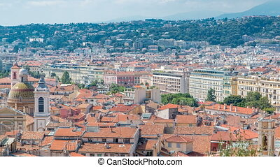 Bright sun lights red roofs of the old city timelapse. Aerial view from Shatto's hill. Nice, France