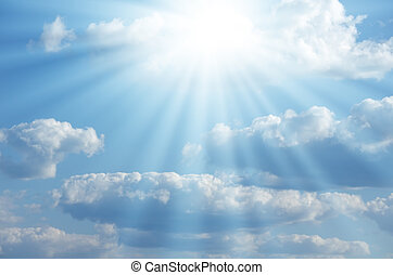 Bright sun shines among the white clouds