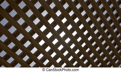 Bright sun shining through the wooden net shed - Slow motion...