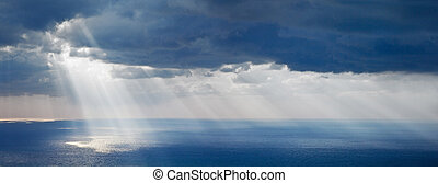 Bright sunlight over ocean, beautiful shine sun beam in sky...