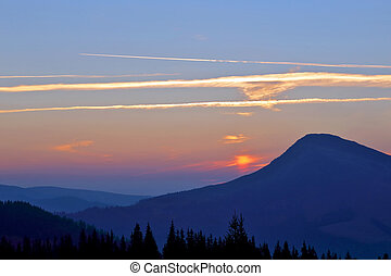 bright sunny dawn on the mountain slopes