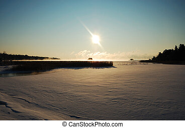 Bright sunny winter day on a frozen lake