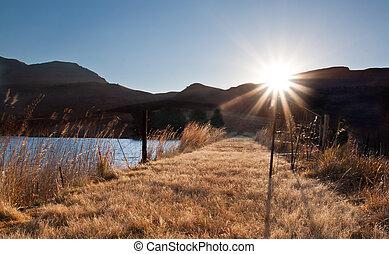 Bright sunrise over mountain