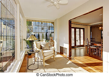 Bright sunroom with antique chair