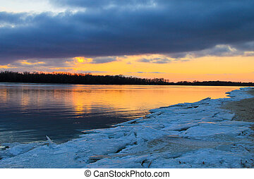 Bright sunset over a river Dnieper on winter