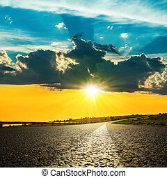 bright sunset over asphalt road