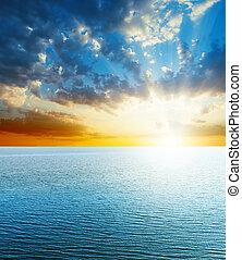 bright sunset over blue sea