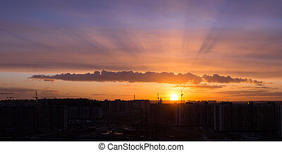 bright sunset with clouds over city