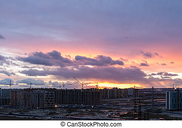 sunset with clouds over the city