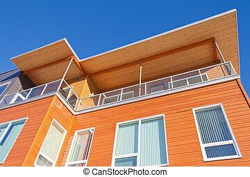 Bright timber clad condo building exterior detail